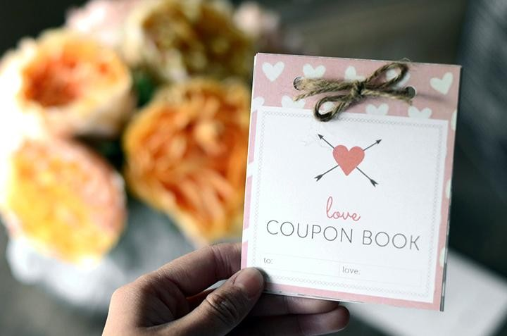 hand-with-Valentines-Day-coupon-book-720x477