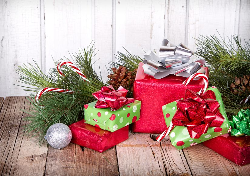 15911738 - christmas presents and ornaments on wooden background with pine branches